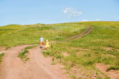 Landscape with running children. Landscape with the quiet sky and children running on road royalty free stock image