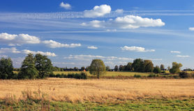 Landscape with running clouds. Landscape in a countryside in the early autumn, in the evening Royalty Free Stock Images