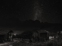 Landscape rural area on mountain at night with clear sky full of stars, in Thailand, Black and White Stock Image