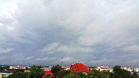 Landscape of rural city with red roof temple and cloudy sky Royalty Free Stock Images