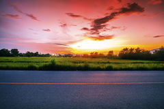 Landscape of rural road at dusk Royalty Free Stock Photo