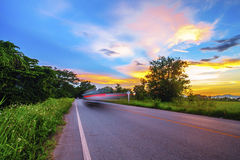 Landscape of rural road at dusk Stock Photos