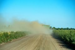 Rural road and dust after a car Stock Images