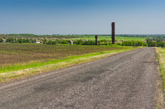 Landscape with rural road to remote Ukrainian village at spring season Royalty Free Stock Photography