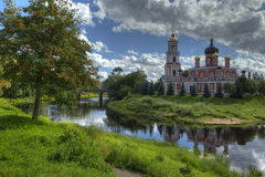 Landscape with the Russian Church on the River Bank Royalty Free Stock Image