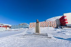 Russian city of Barentsburg on the Spitsbergen archipelago in the winter in the Arctic In sunny weather and blue sky stock photography