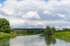 Landscape with the Russian Orthodox Church and cloudy sky. Russi Royalty Free Stock Photography