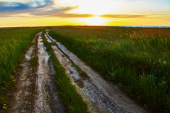 Landscape with rut road in steppe Stock Images