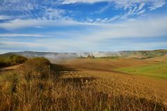 Landscape of San Quirico d`Orcia, Tuscany, Italy. Scenic Tuscan landscape with beautiful fields, meadows and hills. San Quirico d`Orcia, Tuscany, Italy Royalty Free Stock Image