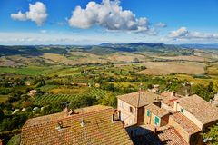 Landscape of San Quirico d`Orcia, Tuscany, Italy. Scenic Tuscan landscape with beautiful fields, meadows and hills. San Quirico d`Orcia, Tuscany, Italy Stock Images