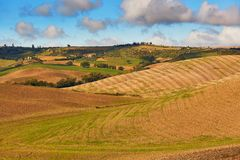 Landscape of San Quirico d`Orcia, Tuscany, Italy. Scenic Tuscan landscape with beautiful fields, meadows and hills. San Quirico d`Orcia, Tuscany, Italy Stock Photos
