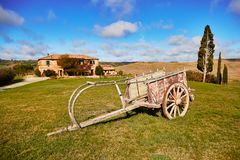 Landscape of San Quirico d`Orcia, Tuscany, Italy. Scenic Tuscan landscape with cart, beautiful fields, meadows and hills. San Quirico d`Orcia, Tuscany, Italy Stock Images