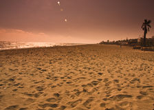 Landscape sand sea sky. Beach sunset with expanse of empty sand with footprints Royalty Free Stock Photos