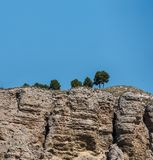 Landscape of sandstone mountain with some trees and blue sky stock photos