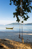 Landscape a sandy beach in tropics, a swing Royalty Free Stock Photos