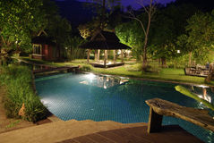 Swimming pool in resort at night Royalty Free Stock Images