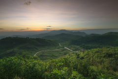 Landscape scene of natural mountain and rural roads through the royalty free stock images