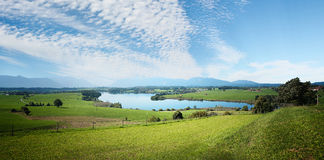 Landscape scenery with fleecy clouds Royalty Free Stock Photo