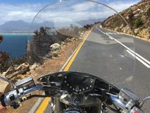 Garden route on a bike, road near Chapman`s peak, South Africa royalty free stock photography