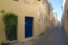Malta, Rabat: Narrow street in old city quart. Landscape of a scenic, narrow street, typical for the old city quart of Rabat, Malta Royalty Free Stock Images