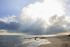 Landscape of sea, beach and cloudy sky which has sun beam Royalty Free Stock Photos