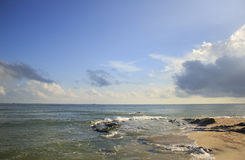 Landscape of sea, beach and cloudy sky which has sun beam Stock Image