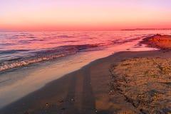 Landscape of sea, beach, sunset at sea, red sky, fiery sunset Stock Photos