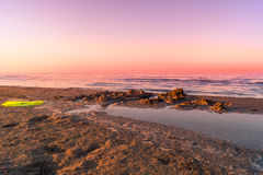 Landscape of sea, beach, sunset at sea, red sky, fiery sunset Royalty Free Stock Photography