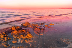 Landscape of sea, beach, sunset at sea, red sky, fiery sunset Stock Images