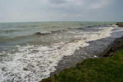 Landscape by the sea, choppy water,  lowering sky Stock Photos