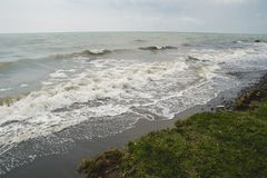 Landscape by the sea, choppy water,  lowering sky Stock Photo