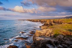 Landscape of sea, cliff, blue sky with clouds. Touristic travel. Landscape of sea, cliff blue sky with clouds. Ocean coast in the north west of Spain, Galicia stock images