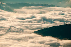 Landscape with sea of clouds in the mountains. Nice landscape with a mountain valley covered with a sea of clouds Stock Photo