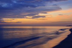 Landscape of sea and cloudy sky at dawn ; Songkhla Thailand. (slow shutter speeds stock photos