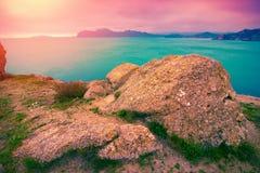 Landscape with sea coast and mountains at sunrise stock photo