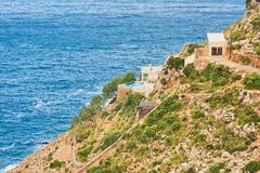 Landscape with sea and house on the mountainside under the blue sky royalty free stock photography