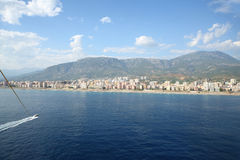 Landscape of sea and mountain with the coastline, beachs and hotels. From flight with Parachute hitched to the boat Royalty Free Stock Photos