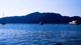 Landscape of sea and mountains with 3 boats. Photo Royalty Free Stock Photos