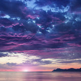 Landscape with sea and mountains on sunrise Royalty Free Stock Images