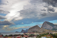 Landscape on the sea resort with beautiful mountains and picturesque sky, Crimea Stock Images