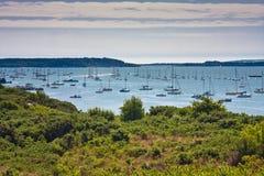 Landscape sea sky boats. Dorset coastline of gorse, boats, sea and sky Royalty Free Stock Images