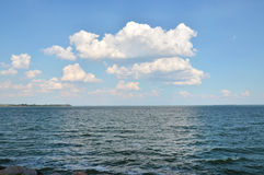 Landscape: sea, sky, clouds. Seascape, white clouds in the sky, blue water, waves Stock Photo