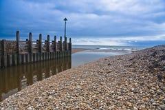 Landscape sea sky pebbles. Somerset coastline estuary sea and sky Royalty Free Stock Photos