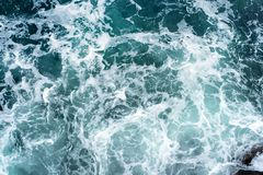 Landscape of sea waves and foam breaking on rocks royalty free stock images