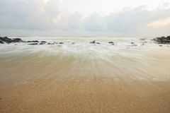 Landscape of sea which have breakwater and cloudy sky on windy day ; Songkhla Thailand. (slow shutter speeds Stock Photography