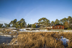 Landscape by the sea in the winter (cabin). Dusa is a recreation area located just outside Halden and is used in summer for swimming and recreation, and it's Stock Photography