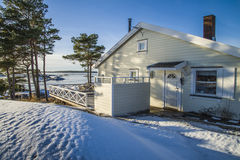 Landscape by the sea in the winter (cabin). Dusa is a recreation area located just outside Halden and is used in summer for swimming and recreation, and it's Stock Images