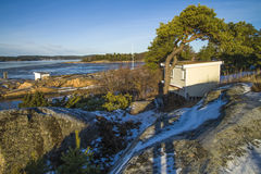 Landscape by the sea in the winter (outhouse). Dusa is a recreation area located just outside Halden and is used in summer for swimming and recreation, and it's Stock Photo