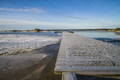 Landscape by the sea in the winter (pier). Dusa is a recreation area located just outside Halden and is used in summer for swimming and recreation, and it's Royalty Free Stock Photos