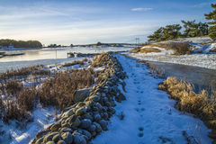 Landscape by the sea in the winter (stone fence). Dusa is a recreation area located just outside Halden and is used in summer for swimming and recreation, and it Royalty Free Stock Photos